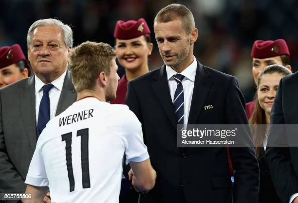 Timo Werner of Germany shakes hands with UEFA President Aleksander Ceferin at the award ceremony after the FIFA Confederations Cup Russia 2017 Final...