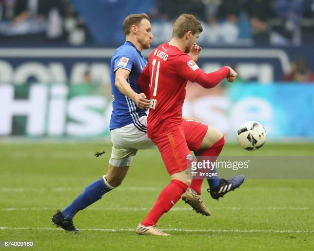 Timo Werner of Leipzig and Benedikt Hoewedes of Schalke battle for the ball during the Bundesliga match between FC Schalke 04 and RB Leipzig at...