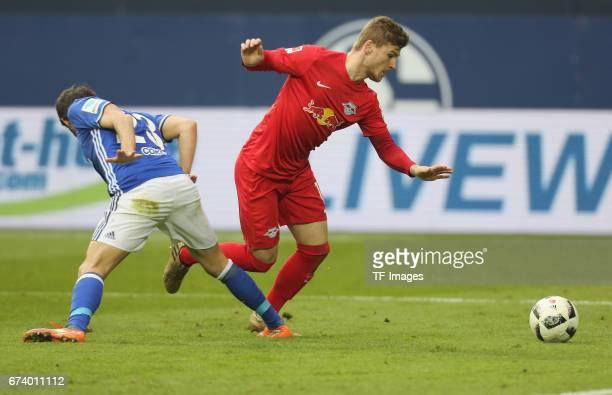 Timo Werner of Leipzig and Coke of Schalke battle for the ball during the Bundesliga match between FC Schalke 04 and RB Leipzig at VeltinsArena on...