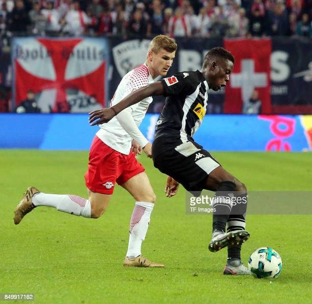 Timo Werner of Leipzig and Denis Zakaria of Moenchengladbach battle for the ball during the Bundesliga match between RB Leipzig and Borussia...