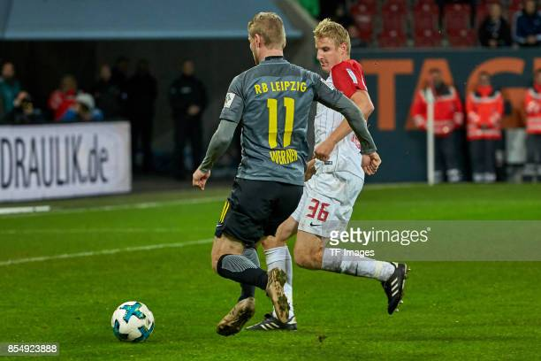 Timo Werner of Leipzig and Martin Hinteregger of Augsburg battle for the ball during the Bundesliga match between FC Augsburg and RB Leipzig at...
