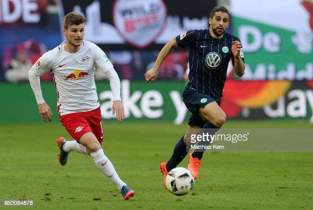 Timo Werner of Leipzig battles for the ball with Ricardo Rodriguez of Wolfsburg during the Bundesliga match between RB Leipzig and VfL Wolfsburg at...