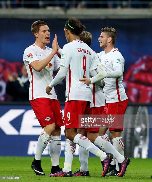 Timo Werner of Leipzig celebrates after scoring his team's third goal with and Emil Forsberg Yussuf Poulsen and Marcel Halstenberg of Leipzig during...