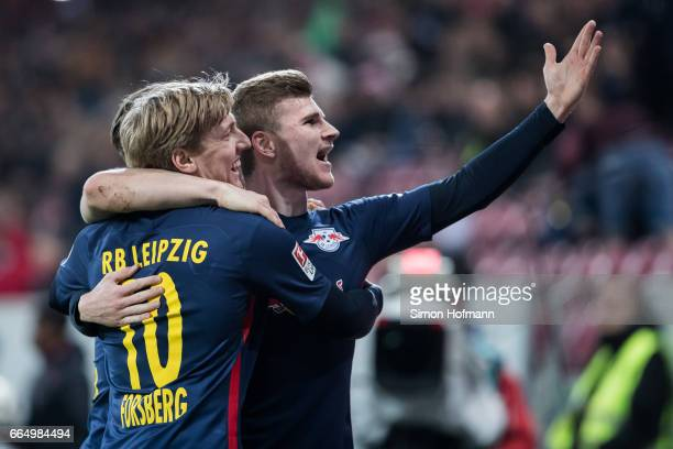 Timo Werner of Leipzig celebrates his team's second goal with team mate Emil Forsberg during the Bundesliga match between 1 FSV Mainz 05 and RB...
