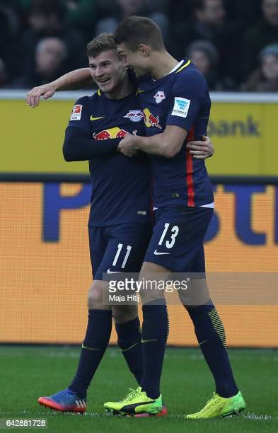 Timo Werner of Leipzig celebrates scoring his teams second goal with Stefan Ilsanker during the Bundesliga match between Borussia Moenchengladbach...