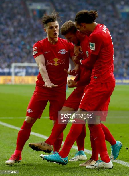 Timo Werner of Leipzig celebrates with team mates after scoring hi teams first goal during the Bundesliga match between FC Schalke 04 and RB Leipzig...