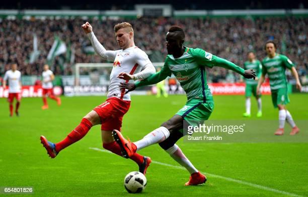 Timo Werner of Leipzig challenges Famine Sane of Bremen during the Bundesliga match between Werder Bremen and RB Leipzig at Weserstadion on March 18...
