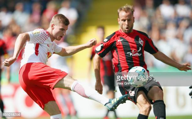 Timo Werner of Leipzig is challenged by Carl Murphy of Dorfmerkingen during the DFB Cup first round match between Sportfreunde Dorfmerkingen and RB...