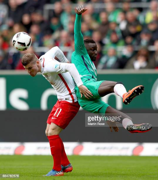 Timo Werner of Leipzig is challenged by Famine Sane of Bremen during the Bundesliga match between Werder Bremen and RB Leipzig at Weserstadion on...