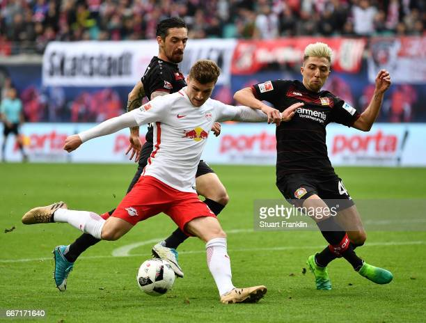 Timo Werner of Leipzig is challenged by Kevin Kampl of Leverkusen during the Bundesliga match between RB Leipzig and Bayer 04 Leverkusen at Red Bull...