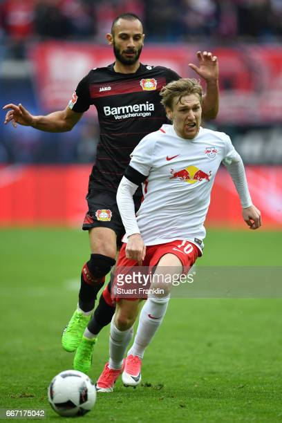 Timo Werner of Leipzig is challenged by mer Toprak of Leverkusen during the Bundesliga match between RB Leipzig and Bayer 04 Leverkusen at Red Bull...