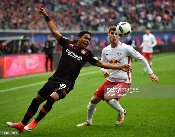 Timo Werner of Leipzig is challenged by Wendellof Leverkusen during the Bundesliga match between RB Leipzig and Bayer 04 Leverkusen at Red Bull Arena...