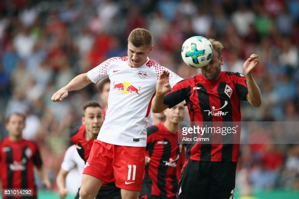 Timo Werner of Leipzig jumps for a header with Carl Murphy of Dorfmerkingen during the DFB Cup first round match between Sportfreunde Dorfmerkingen...
