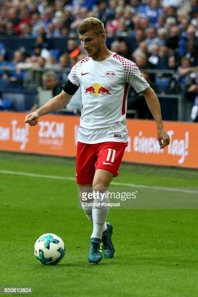 Timo Werner of Leipzig runs with the ball during the Bundesliga match between FC Schalke 04 and RB Leipzig at VeltinsArena on August 19 2017 in...