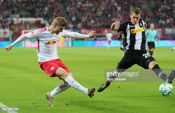 Timo Werner of Leipzig shoots past Matthias Ginter of Moenchengladbach during the Bundesliga match between RB Leipzig and Borussia Moenchengladbach...