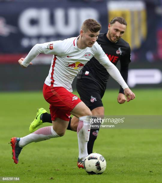 Timo Werner of Leipzig with with Marco Hoeger of Koeln during the Bundesliga match between RB Leipzig and 1 FC Koeln at Red Bull Arena on February 25...