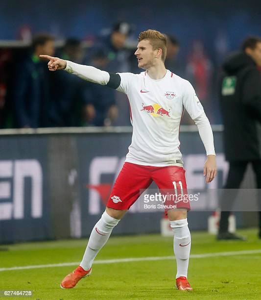 Timo Werner of RB Leipzig celebrates after scoring his team's first goal during the Bundesliga match between RB Leipzig and FC Schalke 04 at Red Bull...