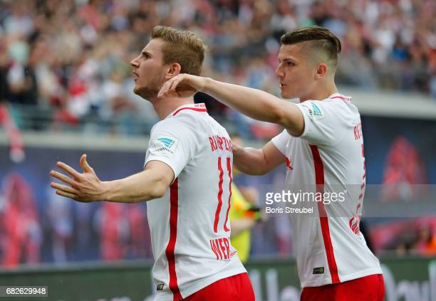 Timo Werner of RB Leipzig celebrates after scoring his team's fourth goal during the Bundesliga match between RB Leipzig and Bayern Muenchen at Red...