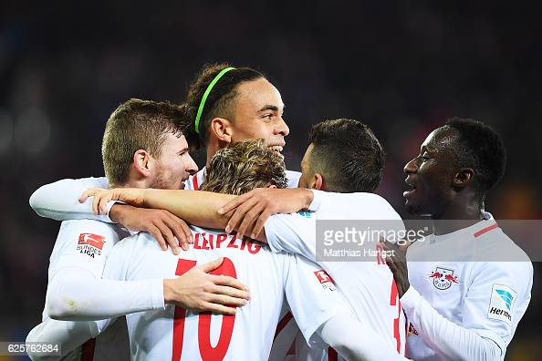 Timo Werner of RB Leipzig celebrates with Yussuf Poulsen of RB Leipzig and team mates after scoring his second goal during the Bundesliga match...