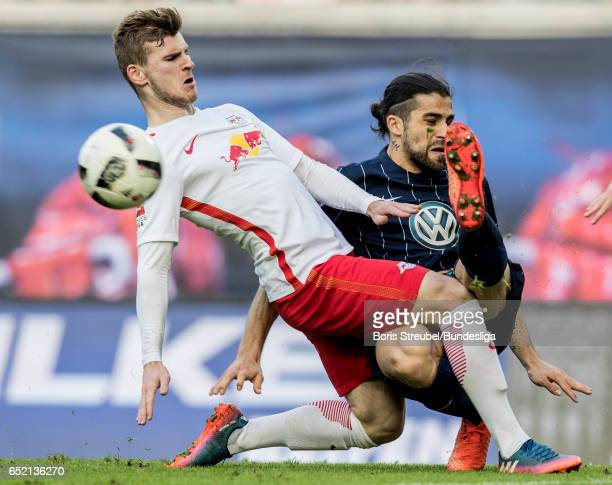 Timo Werner of RB Leipzig is challenged by Ricardo Rodriguez of VfL Wolfsburg during the Bundesliga match between RB Leipzig and VfL Wolfsburg at Red...