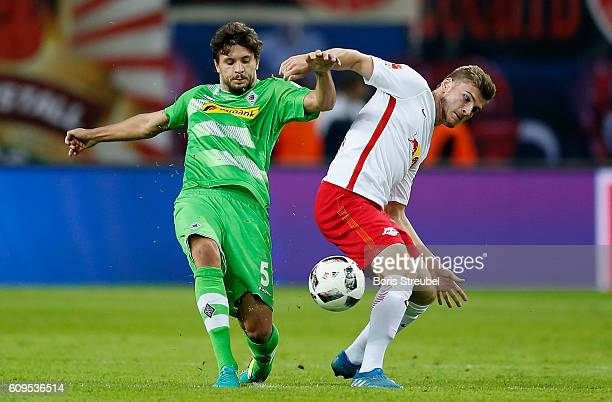 Timo Werner of RB Leipzig is challenged by Tobias Strobl of Borussia Moenchengladbach during the Bundesliga match between RB Leipzig and Borussia...
