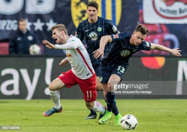 Timo Werner of RB Leipzig is challenged by Yannick Gerhardt of VfL Wolfsburg during the Bundesliga match between RB Leipzig and VfL Wolfsburg at Red...