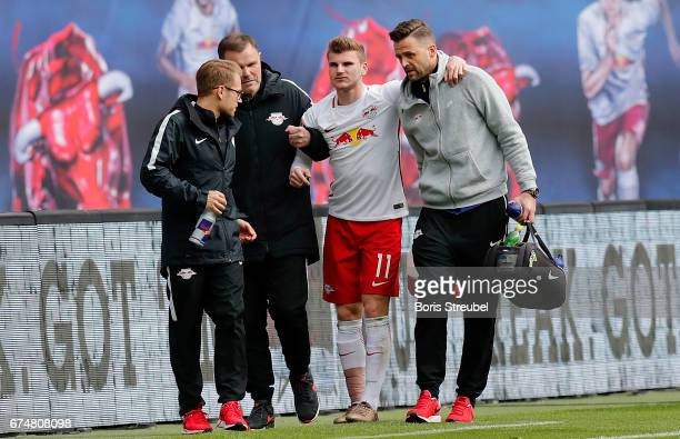 Timo Werner of RB Leipzig leaves the pitch after taking an injury during the Bundesliga match between RB Leipzig and FC Ingolstadt 04 at Red Bull...