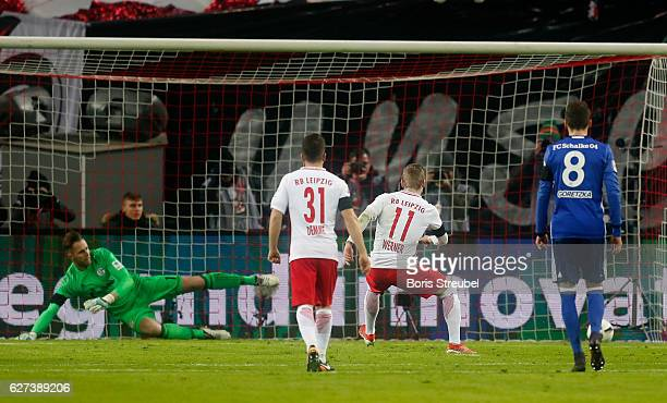 Timo Werner of RB Leipzig scores his team's first goal by penalty against goalkeeper Ralf Faehrmann of FC Schalke 04 during the Bundesliga match...