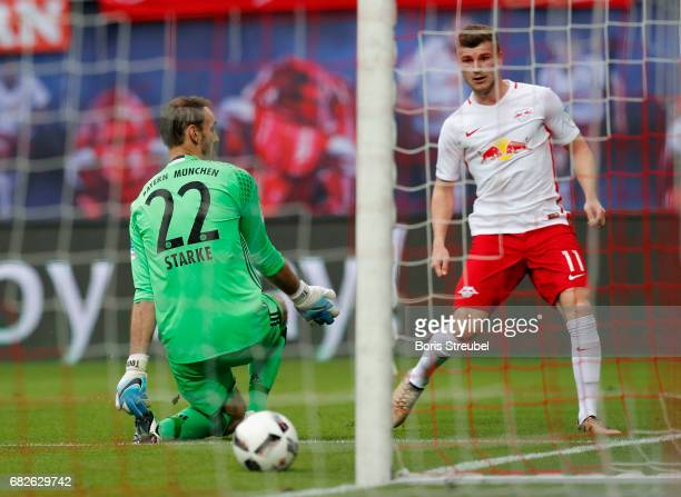 Timo Werner of RB Leipzig scores his team's fourth goal against Goalkeeper Tom Starke of FC Bayern Muenchen during the Bundesliga match between RB...