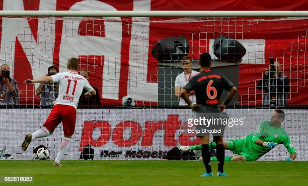 Timo Werner of RB Leipzig scores his team's second goal by penalty against goalkeeper Tom Starke of FC Bayern Muenchen during the Bundesliga match...