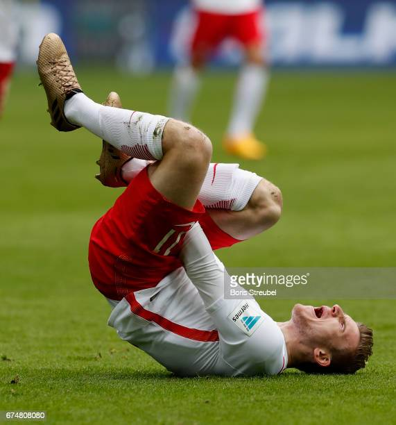 Timo Werner of RB Leipzig takes an injury during the Bundesliga match between RB Leipzig and FC Ingolstadt 04 at Red Bull Arena on April 29 2017 in...