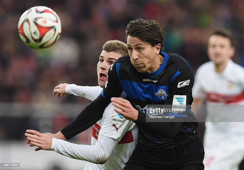 Timo Werner of Stuttgart and Jens Wemmer of Paderborn compete for the ball during the Bundesliga match between VfB Stuttgart and SC Paderborn at...