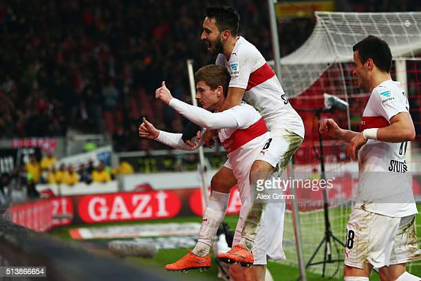 Timo Werner of Stuttgart celebrates his team's fifth goal with team mates Lukas Rupp and Filip Kostic during the Bundesliga match between VfB...