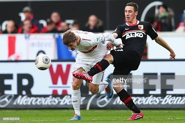Timo Werner of Stuttgart is challenged by Dominik Kohr of Augsburg during the Bundesliga match between VfB Stuttgart and FC Augsburg at MercedesBenz...
