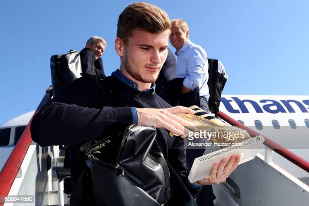 Timo Werner presents the golden shoe trophy prior to the departure of Germany at Sankt Petersburg Pulkovo Airport Airport on July 3 2017 in Saint...