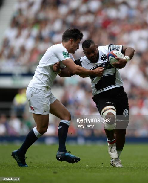 Timoci Nagusa of Barbarians is tackled by Alex Lozowski of England during the Old Mutual Wealth Cup match between England Rugby and the Barbarians at...