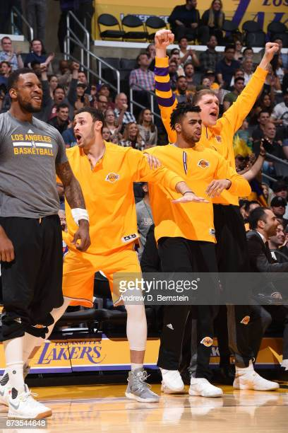 Timofey Mozgov Larry Nance Jr #7 D'Angelo Russell and Tarik Black of the Los Angeles Lakers celebrate during a game against the Milwaukee Bucks on...