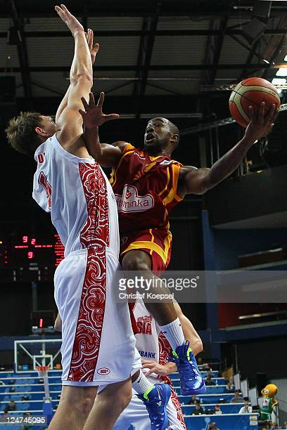Timofey Mozgov of Russia defends against Bo McCalebb of Macedonia during the EuroBasket 2011 second round group F match between Russia and Macedonia...