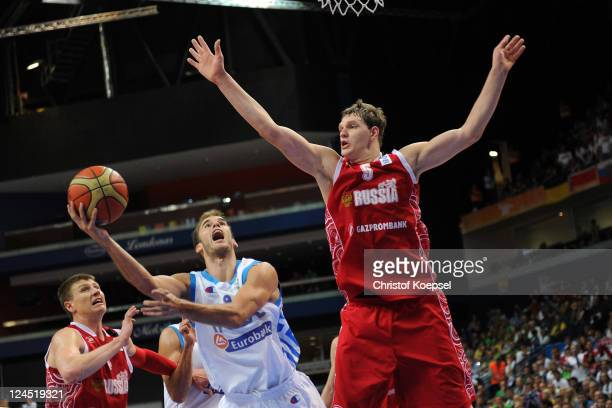 Timofey Mozgov of Russia defends against Nick Calathes of Greece during the EuroBasket 2011 second round match between Greece and Russia at Siemens...
