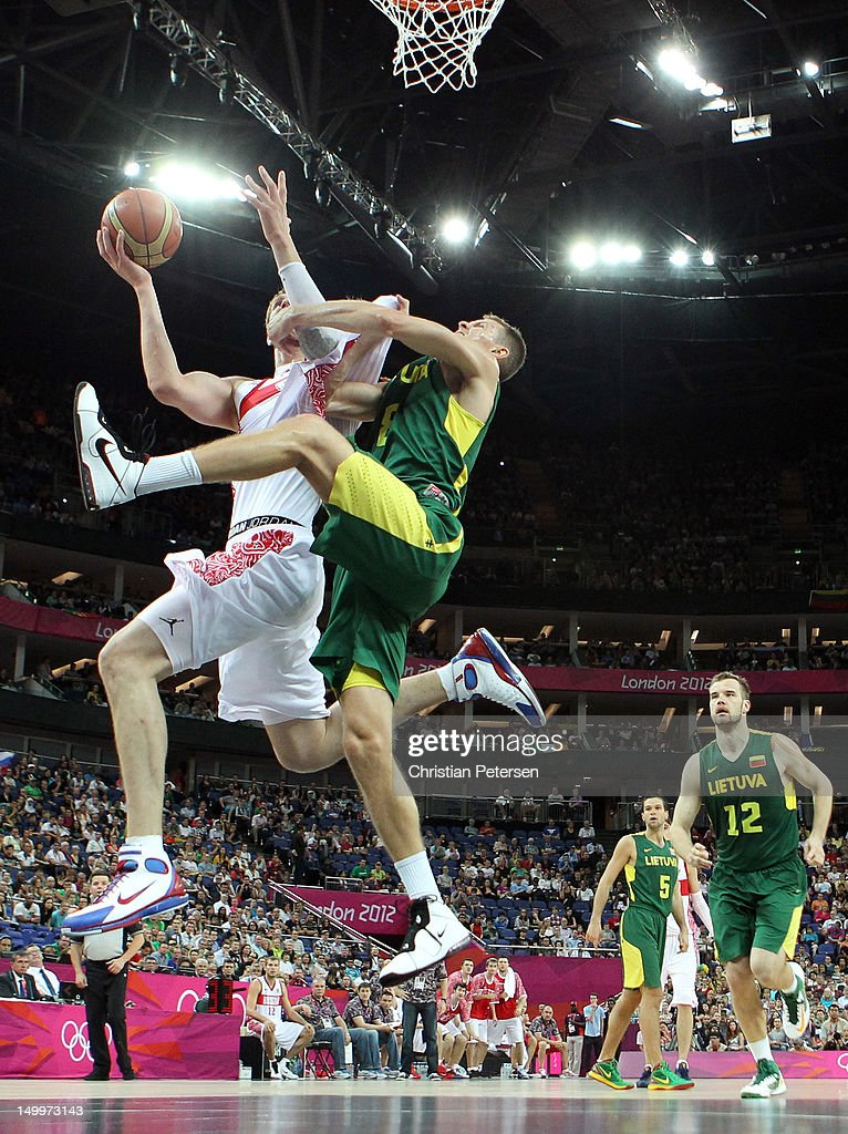 Timofey Mozgov #5 of Russia goes up for a shot against Renaldas Seibutis #8 of Lithuania in the first half during the Men's Basketball quaterfinal game on Day 12 of the London 2012 Olympic Games at North Greenwich Arena on August 8, 2012 in London, England.
