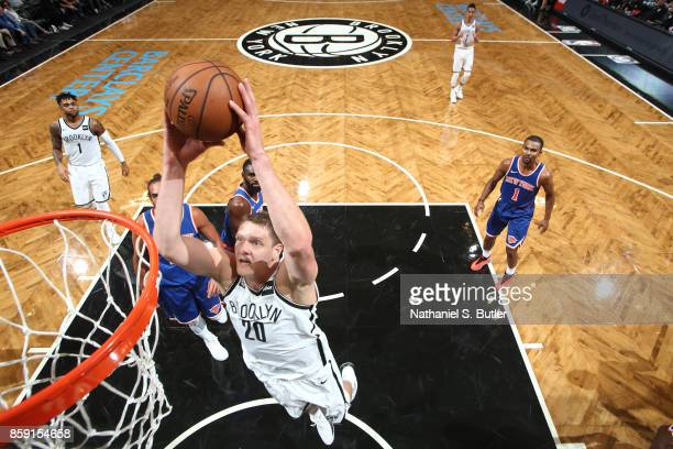 Timofey Mozgov of the Brooklyn Nets goes up for a dunk against the New York Knicks during a preseason game on October 8 2017 at Barclays Center in...