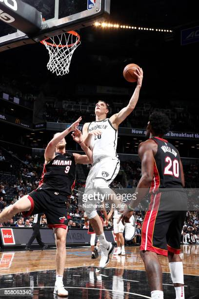 Timofey Mozgov of the Brooklyn Nets shoots a lay up during the game against the Miami Heat during a preseason game on October 5 2017 at Barclays...