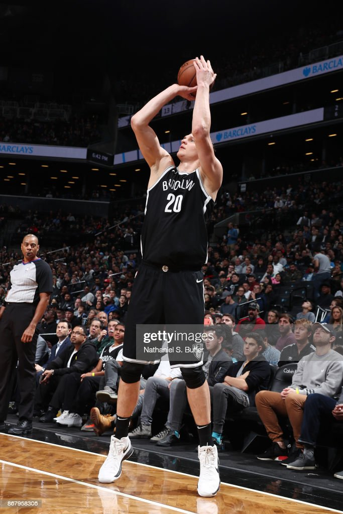 Timofey Mozgov #20 of the Brooklyn Nets shoots the ball against the Denver Nuggets on October 29, 2017 at Barclays Center in Brooklyn, New York.