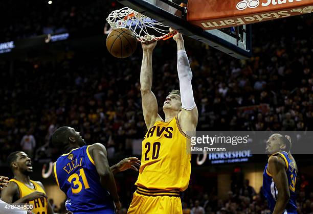 Timofey Mozgov of the Cleveland Cavaliers dunks against Festus Ezeli of the Golden State Warriors in the third quarter during Game Three of the 2015...
