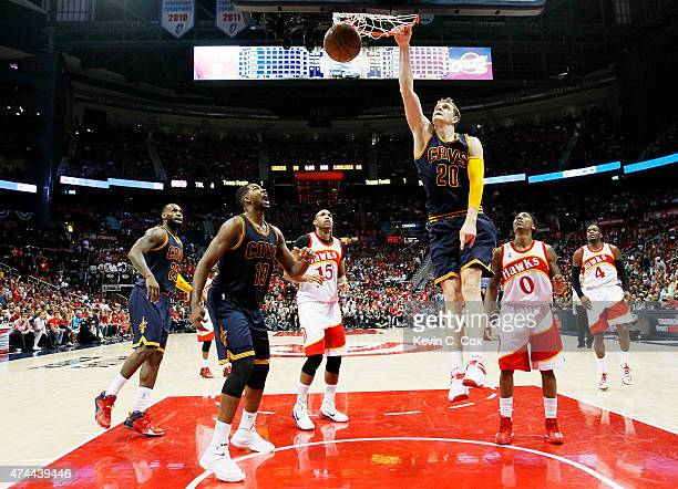 Timofey Mozgov of the Cleveland Cavaliers dunks against the Atlanta Hawks in the third quarter during Game Two of the Eastern Conference Finals of...
