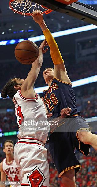 Timofey Mozgov of the Cleveland Cavaliers dunks over Joakim Noah of the Chicago Bulls in Game Four of the Eastern Conference Semifinals of the 2015...