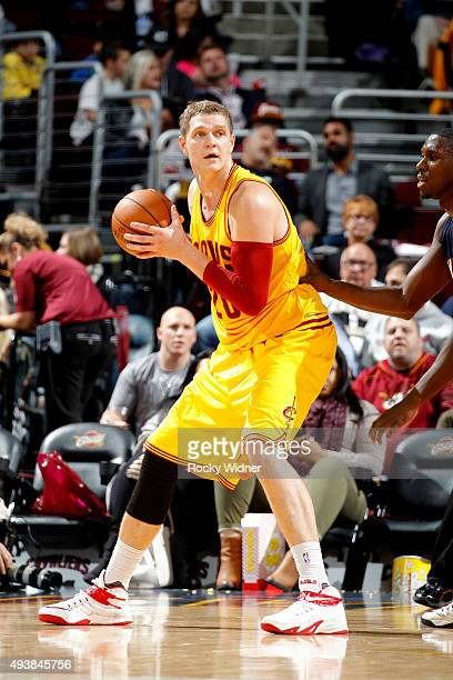 Timofey Mozgov of the Cleveland Cavaliers handles the ball against the Indiana Pacers on October 15 2015 at Quicken Loans Arena in Cleveland Ohio...