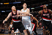 Timofey Mozgov of the Denver Nuggets battles for rebound position with Chris Kaman and LaMarcus Aldridge of the Portland Trail Blazers at Pepsi...