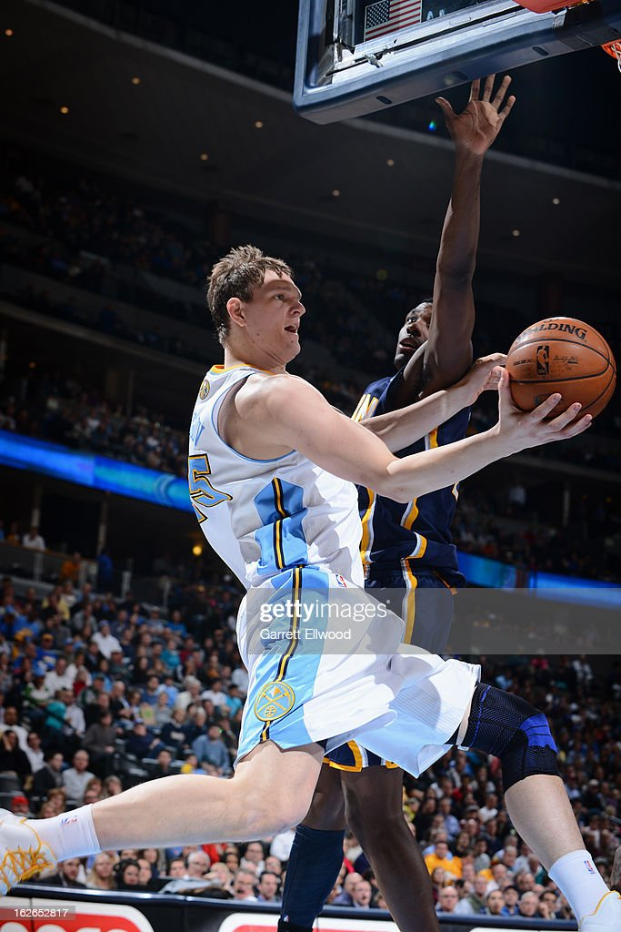 Timofey Mozgov #25 of the Denver Nuggets drives to the basket against the Indiana Pacers on January 28, 2013 at the Pepsi Center in Denver, Colorado.