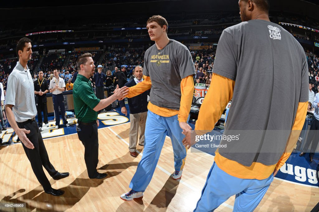 <a gi-track='captionPersonalityLinkClicked' href=/galleries/search?phrase=Timofey+Mozgov&family=editorial&specificpeople=3949705 ng-click='$event.stopPropagation()'>Timofey Mozgov</a> #25 of the Denver Nuggets enters the court before the game against the Houston Rockets on April 9, 2014 at the Pepsi Center in Denver, Colorado.